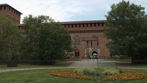 Castello Visconteo castle entrance with flowerbed in Pavia, PV, Italy Footage
