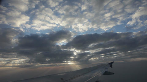 Clouds seen through the window of jet plane Footage