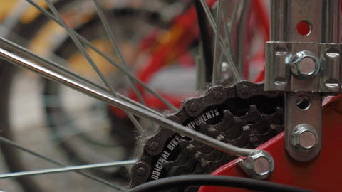 Bikes in a rack, focus shift on bike gears Live Action