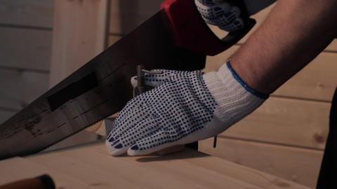 Senior carpenter sawing board ビデオ