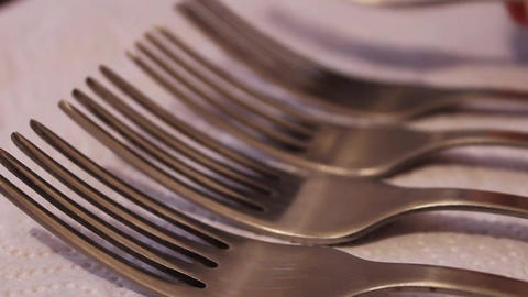 Stacks polished steel forks on a white napkin Bild