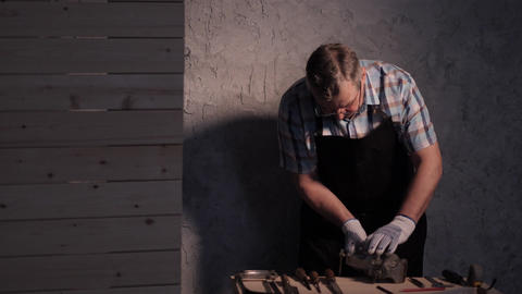 Senior carpenter working with vise Footage