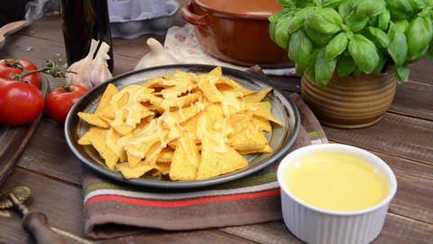 Nachos chips with homemade cheese sauce Footage