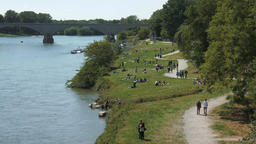 People in the distance enjoying summer on the banks of river Ticino in Pavia, It Footage