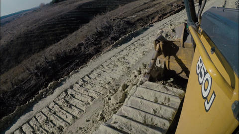 Bulldozer machine working with earth and sand during construction road works Footage