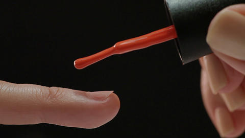 Beautiful manicure process. Nail polish being applied to hand, polish is a red c Live Action