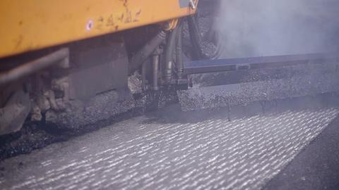 Asphalt paver applying asphalt on the highway. An equipment used to apply asphal Footage