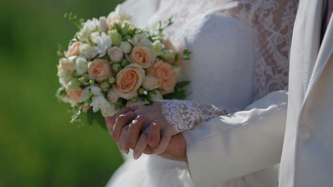 bride and groom holding hands Footage