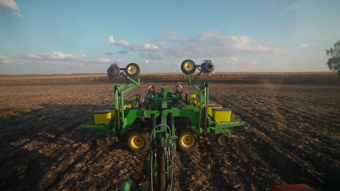 Tractor opens land cultivating machine Footage