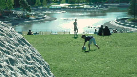 Two little brothers playing ball in the park Footage