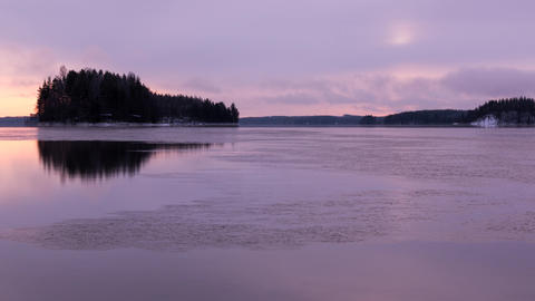 4K Sunrise timelapse of a freezing lake in Finland Footage