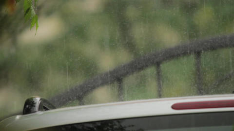 Torrential summer rain on the hood of a car parked in a yard 31 Footage