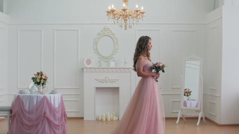 Beautiful bride in pink dress walk in classic style room Footage