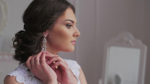 Elegant brunette bride wear beautiful earrings Footage