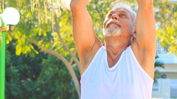 Old Man Does Morning Exercises Lifts Hands up in Park Footage