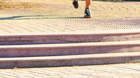 Man Does Morning Exercises Legs Run along Path Steps Footage