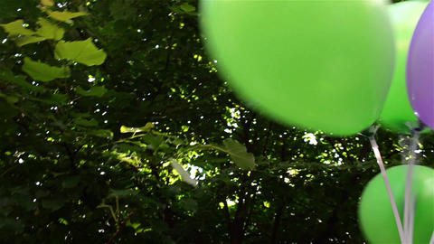 Colorful balloons moved by the energy arm of a child Footage