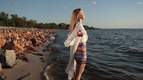 Woman enjoying freedom and life on beach at sunset Footage