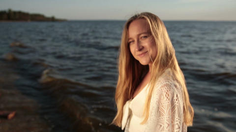Seductive woman enjoying beautiful sunset on beach Footage