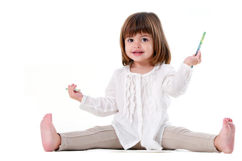 Cute little girl ready to draw with pencils Photo