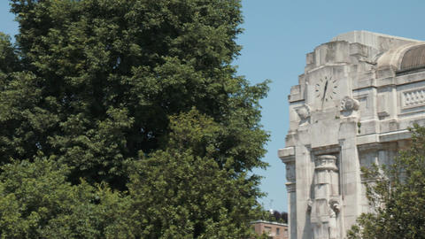 Milan, Italy – May 2016: Panorama of luxury hotel in Milan and clock of centra Footage