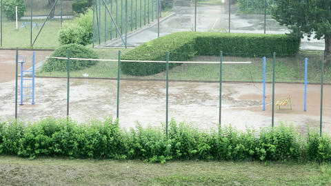 Heavy rain on outdoor tennis or volleyball court and empty playground Footage