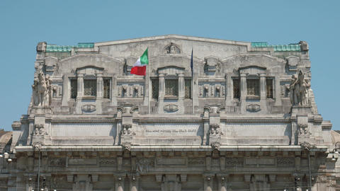 Italian and European flags fluttering in the wind on Milan Central Station Footage
