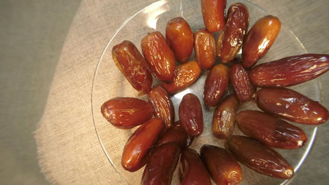 date fruit spin on glassware close-up view from above Stock Video Footage