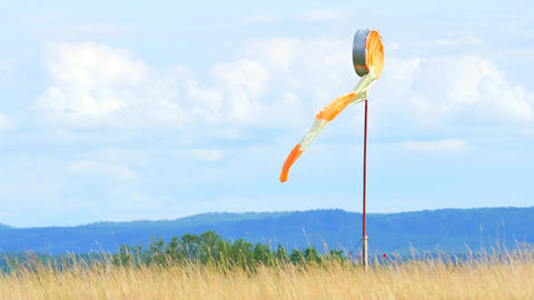 Wind sock fly. Summer hot day on privat sporty airport with abandoned windsock,  Footage