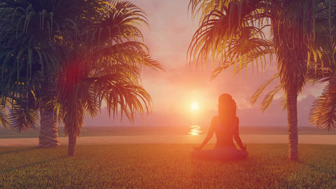 Woman in meditation yoga lotus pose on beach at sunrise or sunset CG動画素材