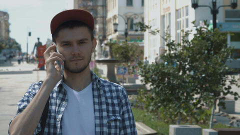 Young handsome man talking on the phone Live Action
