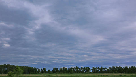 Landscape rural view with fast moving storm clouds. Time Lapse Footage