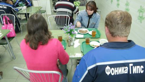 Men and Women Professional Workers Sit at Tables and Dine Live Action
