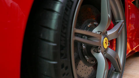 close up of Red Ferrari F430 Scuderia Front Wheel brake system with logotype. at Footage