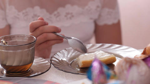 Girl in Beautiful Holiday White Dress Eats Tasty Pie with Tea Footage