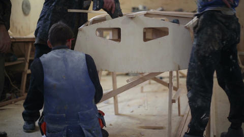 Construction of a boat at the shipyard Live Action