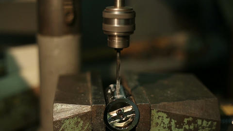 Man drills a detail on a drilling machine Footage