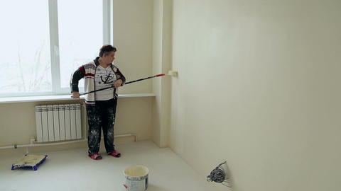 Woman colourer paints the wall Footage