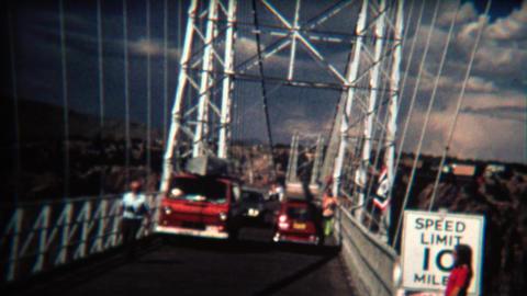 1972: Car crossing narrow suspension bridge on a windy day Footage