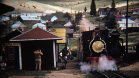1972: Train pulling into station at old western town stop Footage