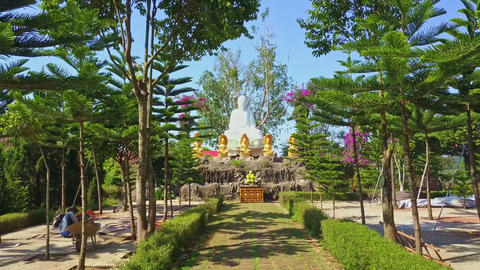 Drone Removes from Marble Buddha Statue across Temple Park Footage