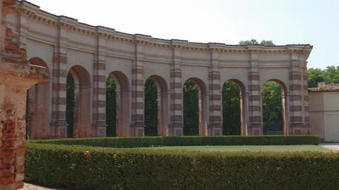Half circle of arches and columns in Palazzo Te garden in Mantua Footage