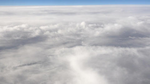 Aerial shot above the clouds in 4K Live Action