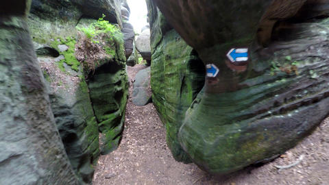 Walk in narrow path in sand rocks corridor like in labyrinth Footage