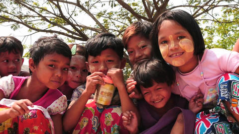 Happy children in Myanmar posing smooth zoom Footage