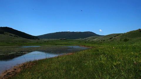 View of the Rascino Lake with the mountains around GIF