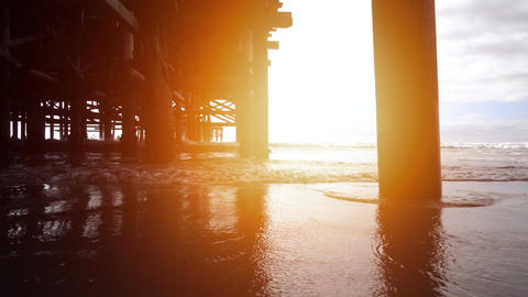 Video of walking under pier in real slow motion Footage