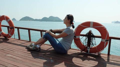 A woman admires the beautiful views of Ha Long Bay Filmmaterial