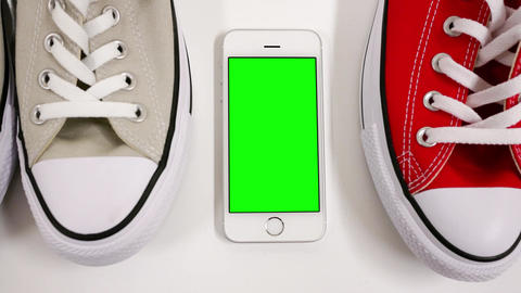 Motion of display shoes and green screen phone on white background for leisure c Footage