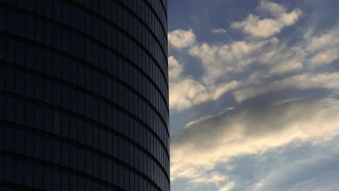 1080p Timelapse With Evening Clouds Flying Past Steel and Glass Round-Shaped Footage